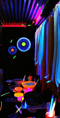 Food Table...glow sticks neon bright serving bowls and tube blacklights