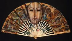 """Fan: 17th century, with peepholes. """"The French designed a fan with glass, or gauze-covered peepholes, such as this one, which allowed ladies to view a scandelous [sic] play. Similarly, other French fans concealed scenes and sayings in their folds so risque that a woman could declare 'a lady hardly knows whether to blush before or behind her fan!'"""" (Image from 29.media.tumblr.c...)"""