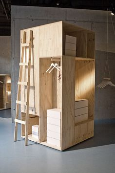 Zalando Pop Up store by Sigurd Larsen, Berlin store design - I could see making this more rectangular in shape and creating a bedroom alcove up top, clothes storage in one cubby, kitchen in another and an all-in-one toilet shower in another!