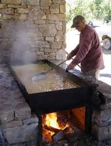 sorghum molasses being cooked - the old fashion way with a fire underneath.