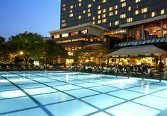 Beautiful night poolside view from near Namsan Mountain at Grand Hyatt Seoul. #grandhyattseoul #poolsidebbq