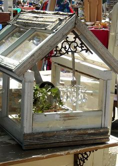 Salvaged windows, trim, tin and a metal plant bracket were joined together to make this terrarium - *The Brambleberry Cottage*: Rally for Raleigh Small Garden Greenhouse, Window Greenhouse, Greenhouse Plans, Vintage Windows, Old Windows, Windows And Doors, Antique Windows, Recycled Door, Garden Projects