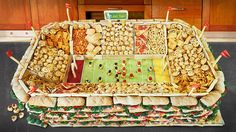 "Go Big or Go Home  You'll leave the game day party competition in the dust with the coolest football food idea around: a completely edible snackadium. Click on the ""+""s above to find out what recipes we used, and click on the how-to below for info on building your own."