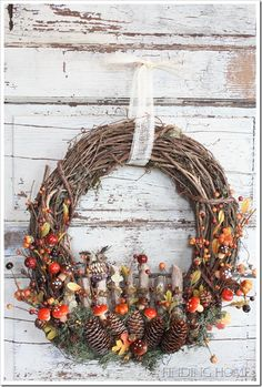 Wow. Fall woodland wreath with an owl on a birch fence and the most adorable little mushrooms. I'm thinking this might be wonderful with a springtime slant, too -- but it's wonderful and it's from Finding Home.