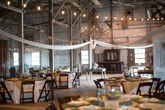 love this warehouse-type space for a reception! | Courtney Dellafiora #wedding