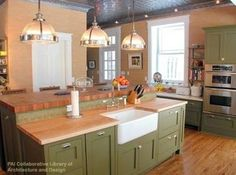 Does anyone have sage green painted wood cabs in their kitchen? I was considering sage green or white and now that I have my layout, thank you GWers!, I have to make my color decision. I have a 1940 cottage style house with a shabby romantic eclectic decor, white trim, butter yellow walls, lace curt...