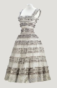 CHRISTIAN DIOR HAUTE COUTURE, F/W 1957-58, 'FUSEAU' LINE A FINE SILVER-GREY TULLE AND VELVET RIBBON TRIMMED DRESS, STUDDED WITH RHINESTONES