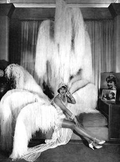 Mistinguett began as a flower seller, singing popular ballads as she sold blossoms. After meeting the director of the revue at the Casino de Paris she began as a stage-hand, eventually appearing in the Folies Bergère and Moulin Rouge. Her risqué routines captivated Paris. She became the highest paid female entertainer in the world. Her legs were insured for 500,000 francs.