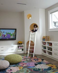 Kids playroom, large floral area rug, knit poufs, custom kids play house with white ladder - Kids Room Ideas Small Playroom, Playroom Design, Playroom Decor, Kids Room Design, Playroom Ideas, Playroom Organization, Organization Ideas, Small Kids Playrooms, Disney Playroom