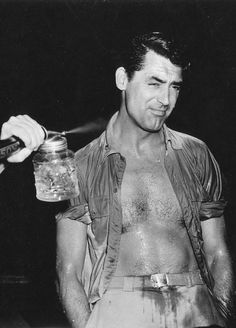 Cary Grant gets hosed down for a scene in Destination Tokyo, 1943.