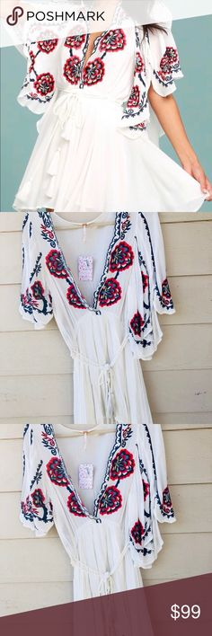 Free people Cora Embroidered Dress Product Detail  Dress by Free People Lightweight woven fabric Deep V-neck Split frill sleeves Embroidered detail Lace trim Regular fit - true to size Machine wash 100% Viscose Free People Dresses Mini