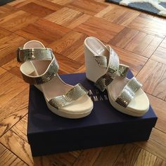 White Stuart Weitzman wedges White Stauart Weitzman wedges with silver sparky ankle strap.  Worn once (wedding night), minor signs of wearing.  Size 5.5 / 36.0 but fit like a size 6 Stuart Weitzman Shoes Wedges