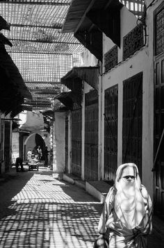 Abbas MOROCCO. Fez. A woman, wearing the traditional veil and face mask, in the souk. 1991.