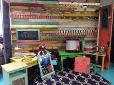 "A Fabulous Pallet Wall. Made by Brooke and  Steph.  They have a booth together at On the Corner in Broken Arrow, OK,  Max and Connie and Gypsie's Junk.  How'd they do it?  Brooke said, ""We painted and stained some, decoupaged with tissue paper, scrap book paper, napkins, fabric, magazine clippings and wrapping paper. A few are embellished with knobs, hooks and fabric flowers."" Beautiful idea for a home, booth, kiosk, pop-up, anyplace!"