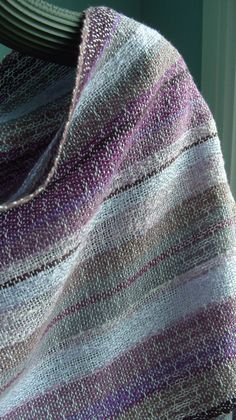 Early morning...dew glistening on a plum harvest...    This shawl/scarf is woven with 100% cotton in the warp and a silvery lilac tencel for the
