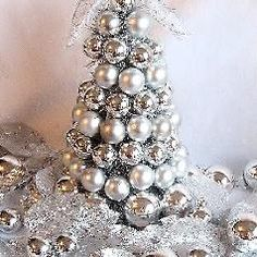 DIY Christmas Bulb Tree this is lots of fun for all the family and everyone can make their own What you will need: Styrofoam Cone Garland of Tinsel Christmas Ornament Bulbs (small and medium) Ribbon Hot Glue Gun Glue Sticks Scissors