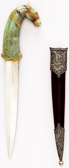 Indian dagger, 18th to 19th century, steel, gold, jade, ruby, emerald, topaz, silver, pearl, wood, velvet, H. with sheath 14 3/4 in. (37.5 cm); H. without sheath 13 7/16 in. (34.1 cm); H. of blade 8 1/2 in. (21.6 cm); W. 3 3/8 in. (8.6 cm); D. 13/16 in. (2.1 cm); Wt. 10.7 oz. (303.3 g); Wt. of sheath 3.2 oz. (90.7 g), Met Museum, Bequest of George C. Stone, 1935.