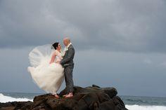 Lace wedding dress on the rocks