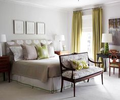 Use a graceful bench to transform the area into an inviting seating spot while balancing the visual presence of a grand bed. To create extra storage, cap off the foot of a bed with a classic trunk. Topped with a soft cushion, the trunk can double as a zone for putting shoes on and taking them off. For flexible seating, align a duo of ottomans at bed's end -- hidden wheels under slipcovered skirts can make it easy to move the pieces as needed.