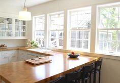 10 Most Popular Kitchen Countertops - Very nice and refreshing, love the natural light and how they placed the sink in front of the window.