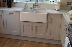 Sheraton Edwardian Painted Kitchen fitted in Wirral, Parkgate, Neston with Itastone Quartz worktops Taupe Kitchen Cabinets, Shaker Style Cabinets, Kitchen Cabinet Colors, Kitchen Paint, Kitchen Design, Tidy Kitchen, Kitchen Tops, Kitchen Ideas, Kitchen Planning