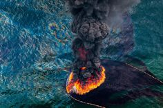 Oil Spill Fire - aerial view of an oil fire following the 2010 Deepwater Horizon oil disaster, Gulf of Mexico… sad but true