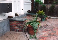 Rollock arch brick steps with stone caps, brick paver patio with herringbone pattern - side view