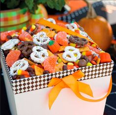 Harvest Snack Mix - This makes a great gift and a yummy treat at a Halloween party!  Ingredients 2 (24-ounce) bags Autumn Mix candy* 2 (1-pound) bags candy-coated peanut butter pieces 2 (1-pound) bags candied orange slices 1 (16-ounce) box baked cheese- flavored snack crackers 1 (12-ounce) box malted milk balls 4 cups chocolate-covered pretzels 4 cups white chocolate-covered pretzels  Instructions 1.Combine all ingredients in a large bowl. Gently toss to mix. Store in an airtight container.