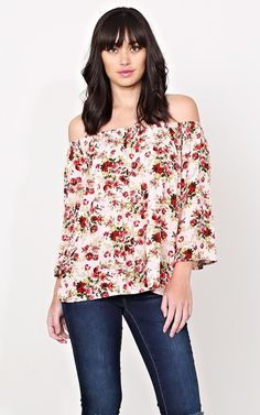 I don't wear it off the shoulders, i wear it on my shoulders, but i LOVE this top! The cut, the colors, the floral. Would love to find another like it. ...maybe a touch longer in the length though.The one I have is a white background, not peach.    Fleeting Floral Peasant Top