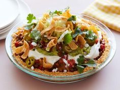 Get Deep-Dish Frito Pie Recipe from Food Network Mexican Dishes, Mexican Food Recipes, Snack Recipes, Cooking Recipes, Snacks, Ethnic Recipes, Fast Recipes, Health Recipes, Top Recipes
