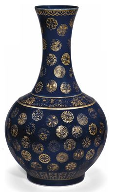 A CHINESE BLUE-GROUND AND GILT-DECORATED BOTTLE VASE  20TH CENTURY  The bombé body and tall flaring neck decorated with scattered gilt medallions of flowers, insects, shou characters and symbols, the rim embellished with a ruyi band