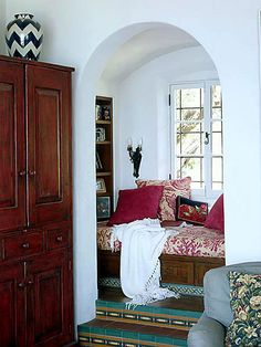 Comfy and cozy reading nook............Soo want one of these in my future master bedroom :)  Different colors tho