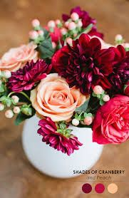 Image result for small floral arrangements for weddings red and peach