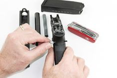 The author uses the tiny screwdriver from his Swiss Army knife as a pin punch to take down this Glock Off Grid Survival, Survival Tools, Survival Stuff, Cool Lock, Types Of Knives, Knife Holder, Glass Breaker, Combat Knives, Best Pocket Knife