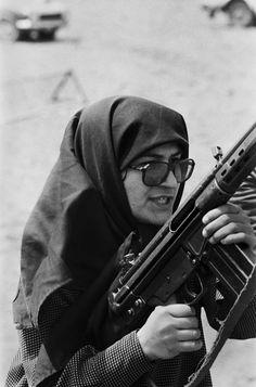 Ashraf Rabiei, a leader of People's Mojahedin, handles a battle rifle at a shooting range near Tehran, April 1979 War Photography, Documentary Photography, Magnum Photos, King Of Persia, Classic Photographers, Pahlavi Dynasty, Iranian Women Fashion, Islamic Images, Religion
