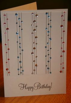"""Draw vertical lines with glue pen, then add fine glitter. Substitute some of the crystal dots with tiny stars, hearts, or evn snowflakes to change the theme of the card. Attach a satin ribbon horizontally at bottom of glitter lines from edge to edge. Accent that ribbon with a 1-2"""" glittered star, heart, snowflake, etc to accentuate the overall theme. This could be a birthday card, Valentine, Christmas card ... any kind of card!"""