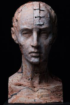 Christian Zucconi, Testa IV (2014). Stone, iron and wax, cm 22 x 24 x 40. www.christianzucconi.it