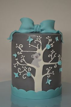 "Koala Barrel Cake  - This is my first barrel cake. It's 6"" round. It has ganache under the fondant (another first for me),  it is adorned in fondant hand cut accents and branches were piped on with royal icing."