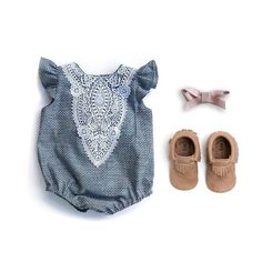 Chambray Dobby Dot Romper with Lace Detail **FOR ANY SIZE OPTION, SPECIFY SIZE IN NOTES SECTION AT CHECKOUT** 100% cotton chambray with woven white dots | lace detail | metal snap crotch | elastic thi
