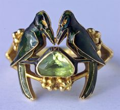 'The Betrothal -To Have & To Hold'. Art Nouveau Ring. Gold, enamel & peridot. Rene Lalique. Circa 1904