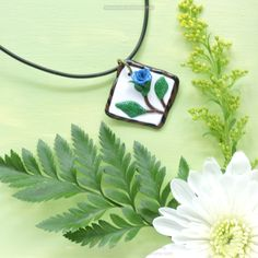 "Flowers are such amazing art created by nature.  They are so different from one another and be just as beautiful.    Handmade with polymer clay, then varnished.  DESCRIPTION It is approximate 1-1/4"" by 1-1/4"" x 3/8"" inch and weighs 5 grams. Necklace Cord is 18 inches long.  Materials: Polymer clay, acrylic paint, end caps, lobster clasp, jump rings, and cord.  $15.00 free shipping within Canada.  See website for details just by clicking on the photo.  Copyright."