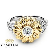 This is a natural diamond sunflower engagement ring from Camellia Jewelry. This unique design ring features a solid 14K two tone gold band with leaf accents and a luminous natural diamond in the center to complete the design. It is an inspired by nature ring that is unlike anything