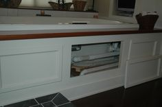 Framing a tub deck/surround - Bathrooms Forum - GardenWeb. Love the ability to open the panels.