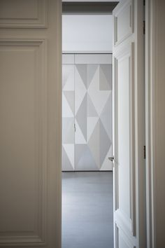 Neutrals | Geometric Wall Mural | Charles Zana adds interest and depth to an otherwise featureless wall with a geometric mural in soft neutrals.
