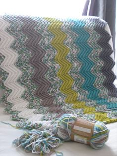 Lovely use of a multicolour with solids for a ripple blanket