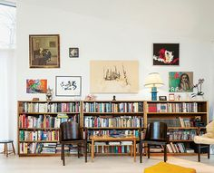 Home is where the bookshelves are. A home library alternative that doesn't involve floor to ceiling bookshelves. I like that the walls are visible (not hidden behind book shelves) and used for pictures.