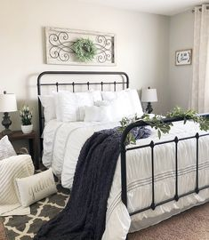 Farmhouse bedroom with rod iron bed, white bedding
