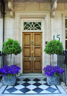 Pi, this would be adorable, painted doormat, topiary (lemon tree) with purple petunias.....it's English ....but easy to do......