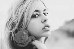 Beautiful girl holding rose in her hand by Jovana Rikalo