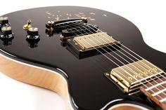 Moniker custom guitar with bird graphic on the body. Design yours online at http://monikerguitars.com